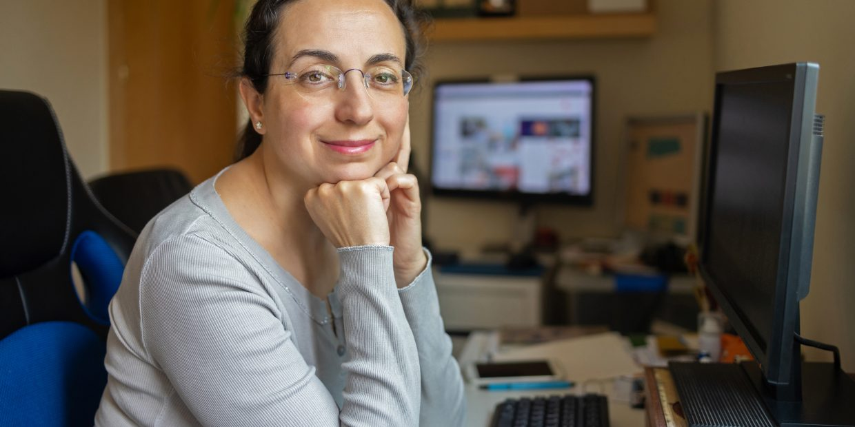 Middle Aged Pretty Woman With Glasses Looking To The Camera And Smiling
